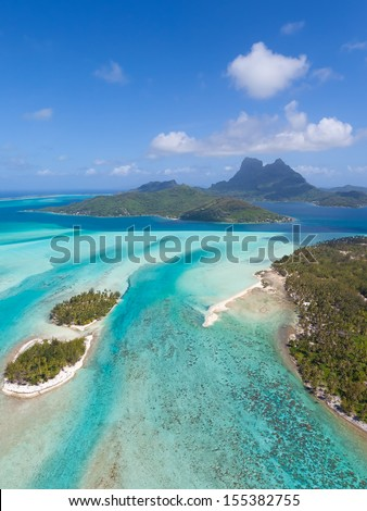 view from helicopter at beautiful island of bora bora, french polynesia - stock photo