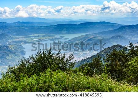 View from hilltop near Antigua of Lake Amatitlan near Guatemala City. - stock photo