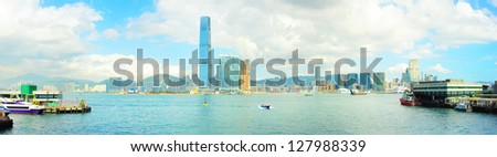 View from Hong Kong to Kowloon island in the sunshine day. Ferry piers on both side of picture. - stock photo