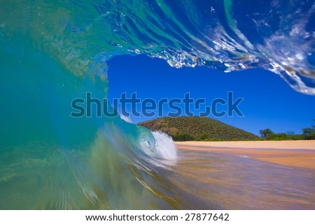 View from Inside the Tube of a Wave looking Towards the Beach, A Surfers Perspective - stock photo