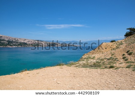 View from Krk island towards mountain Velebit / Beautiful summer seascape at Adriatic sea / Mediterranean seascape / Summer in Baska, Krk, Croatia / View from trekking trail above Baska