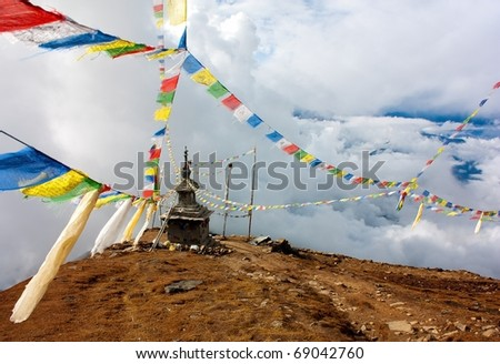 view from Langtang to Ganesh Himal with stupa and prayer flags - Nepal