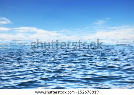 View from low point to sea surface and blank sky with clouds - stock photo