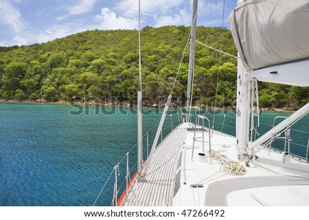 View from luxurious sailboat of beautiful tropical island.