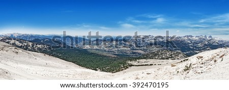 View from Mammoth Mountain in California, in July, with dirty snow in foreground. - stock photo