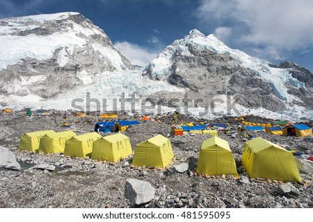 View from Mount Everest base camp, yellow tents and prayer flags, trek to Everest base camp - Nepal