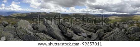 View from Mount Kosciuszko in the Snowy Mountains, New South Wales, Australia. Mt Kosciuszko (2228 m) is the highest peak of Australia. - stock photo