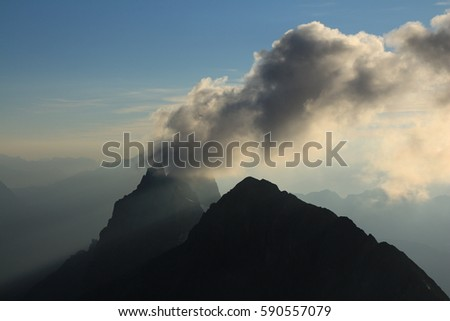 View from mount Titlis. Dramatic clouds over mount Wendenstocke.