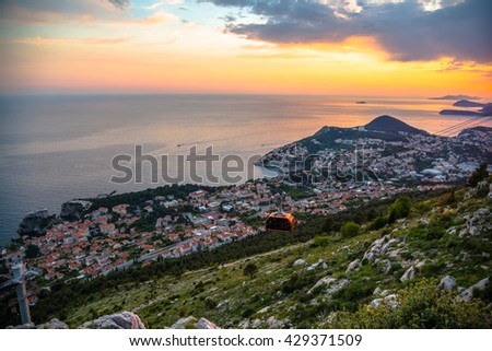 View from mountain at Old town of Dubrovnik in Croatia. Sunset in Adriatic sea. - stock photo