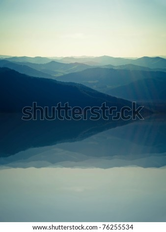 view from mountains with reflection in lake - stock photo