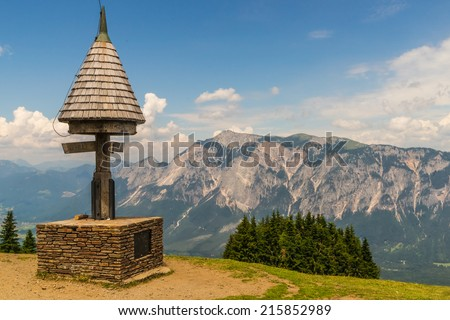 View from Mt. Dreilaendereck at the border of Austria, Italy and Slovenia with it's old monument to the impressive Mt. Dobratsch - stock photo