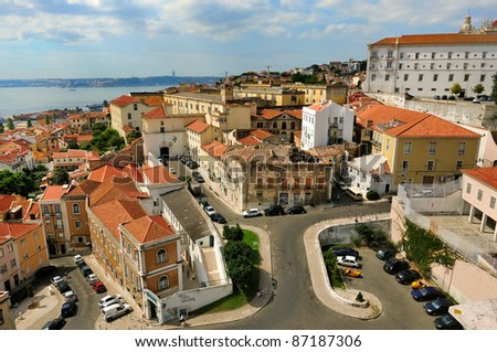 View from National Pantheon in Lisbon / Lisboa - capital of Portugal. Small street of Alfama, river Tagus and 25th of April Suspension Bridge. - stock photo