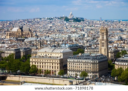 View from Notre Dame in Paris, in the background of the Basilica Sacre Coeur. - stock photo
