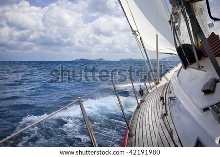 View from onboard luxury sailboat sailing through the tropics. - stock photo