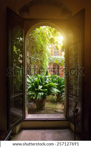View from open window to the garden. - stock photo