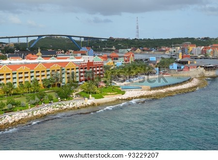 view from Otrobanda towards Willemstad, viewing the coastline with the Konigin Juliana bridge in the background;  Willemstad, Curacao - stock photo