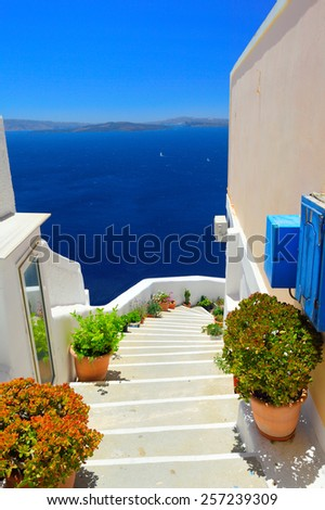 View from pictoresque village Oia into volcanic caldera, Santorini island, Cyclades, Greece - stock photo
