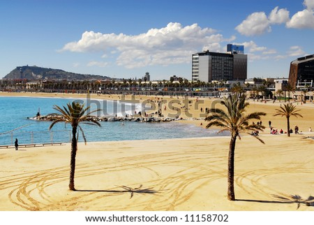 View from Port Olympic on Barcelona beach and Montjuic - stock photo