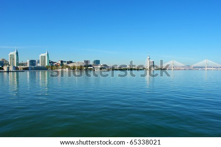 "View from river Tagus of Lisbon's Nations park and ""Vasco da Gama"" Bridge, Portugal - stock photo"