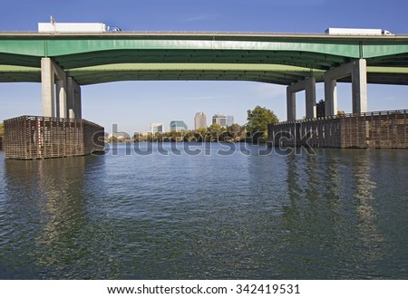 View from Sacramento River of Pioneer Memorial Bridge and downtown Sacramento in far background - stock photo