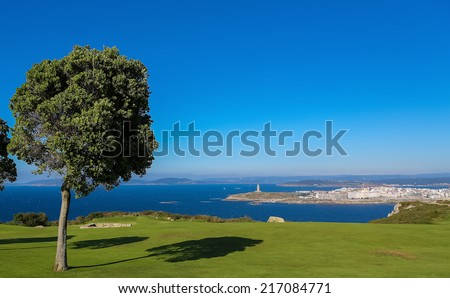 View from San Pedro mountain on the famous lighthouse or Hercules Tower of A Coruna, Galicia, Spain. This lighthouse is more than 1900 years old and is the oldest Roman lighthouse in use today. - stock photo