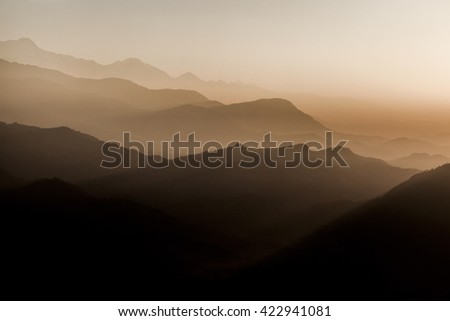 View from Sarangkot viewing point on Annapurna range in fog during dawn in sepia. Sarangkot is located 1592m or 5500ft above see level and is the highest viewing point in Pokhara area.