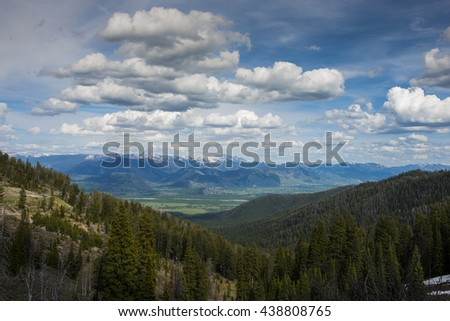 View from scenic Teton Pass looking down the mountain to Jackson Hole valley below - stock photo
