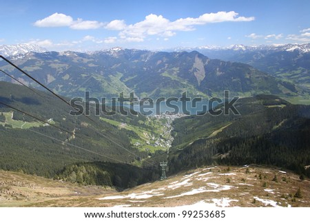 View from Schmittenhoehe to Lake Zell - Austria. Panorama with mountains in the background.