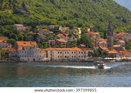 View from sea on the village Perast on coast of Boka Kotor bay. Montenegro. Adriatic sea. - stock photo