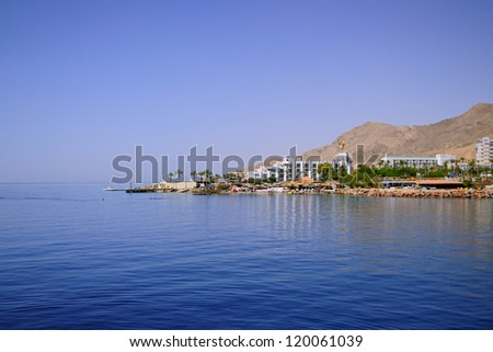 view from sea to the resort in Eilat on Red Sea - stock photo