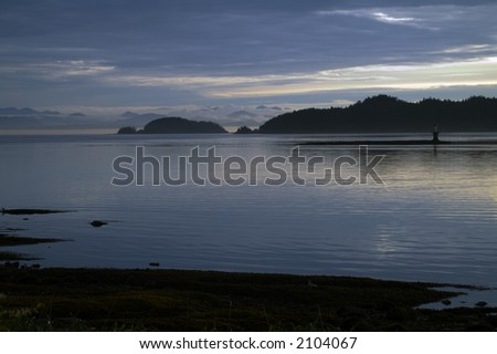 View from ship traveling down the inside passage in Alaska - stock photo