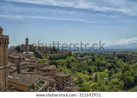 View from Sienna on the surrounding green hills in Tuscany - stock photo