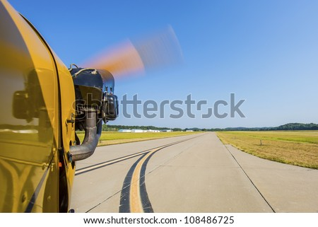 View from small aircraft taxing off from runway - stock photo