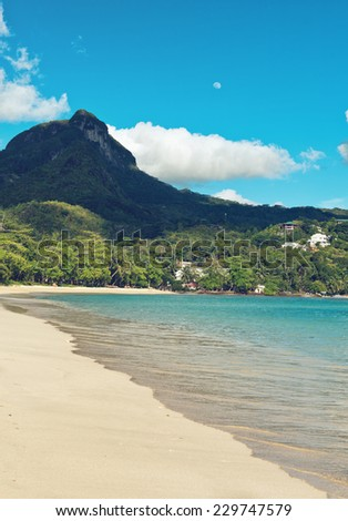 View from South Beach, Port Launay, Mahe of Morne Seychellois, the highest mountain peak on the island - stock photo