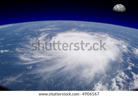 View from space of a giant hurricane over the ocean with moon in background. - stock photo