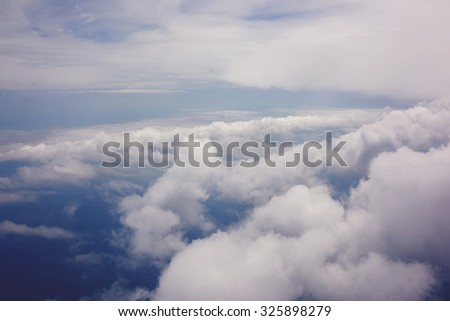 View from the airplane of a bewitching cumulus white clouds background with copy space for your text message or promotional content, background for advertising - stock photo