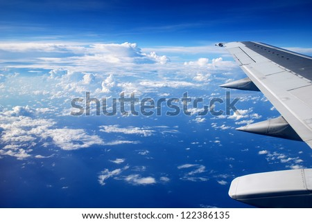 view from the airplane window, ocean blue - stock photo