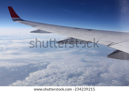 view from the airplane, wings sky - stock photo