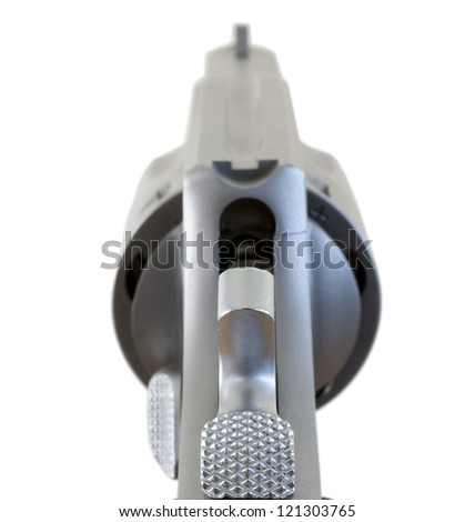 View from the back of a revolver as the hammer is back - stock photo
