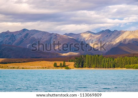 view from the beautiful blue lake Pukaki, New Zealand, South Island - stock photo
