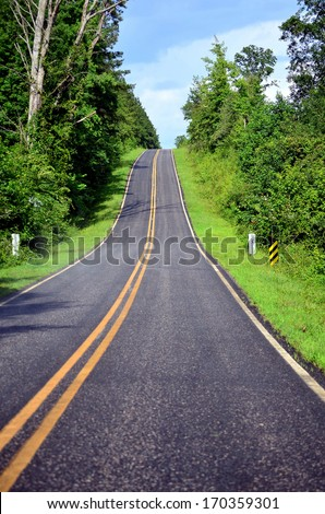 View from the bottom of a steep hill on the highway. - stock photo