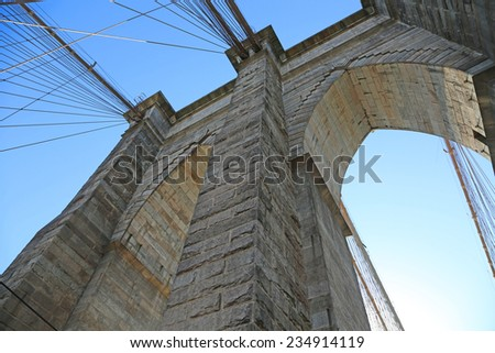 View from the bottom on the pylon of Brooklyn Bridge, New York City - stock photo