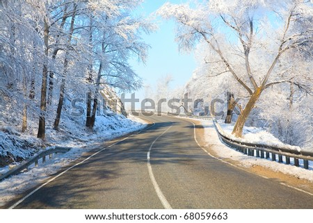 view from the car on winter roads - stock photo