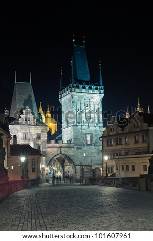 View from the Charles Bridge at Mala Strana in prague, Czech Republic. On the photo could be seen two Bridge towers and the Church of Saint Nicholas. v