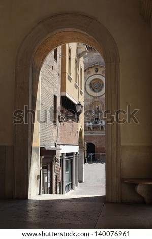 View from the church over to the tower with an old clock - Mantua, Italy - stock photo