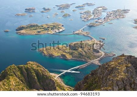 view from the cliff to the sea and the city on the islands - stock photo