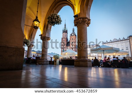 View from the Cloth Hall to the Cracow main market square and St. Mary's Basilica also known as Mariacki Church. - stock photo