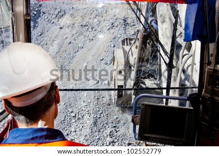 view from the cockpit of large mining excavator - stock photo