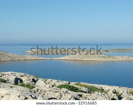 View from the Croatian island Smocvica at the Kornati archipelago - stock photo