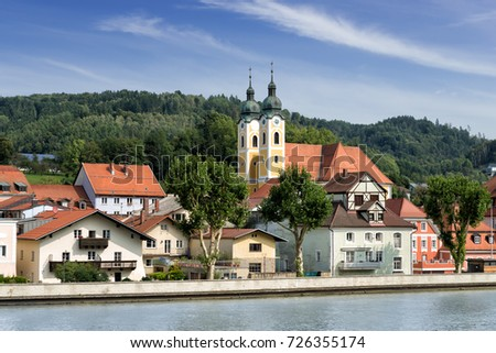 View from the Danube river of the municipality of Obernzell, with the Parish Church of St. Mary of the Assumption in the center, in the district of Passau in Bavaria, Germany.